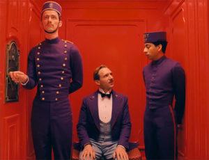 M. Gustave (au centre) et Zero (à droite)